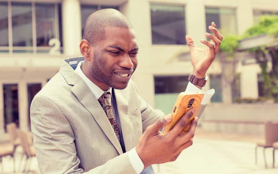 frustrated-business-man-on-mobile-phone